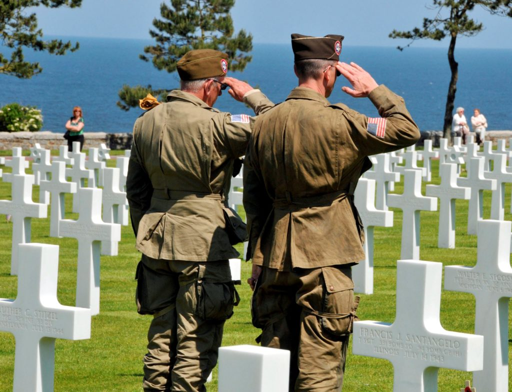 American soldiers giving tribute in cemetery