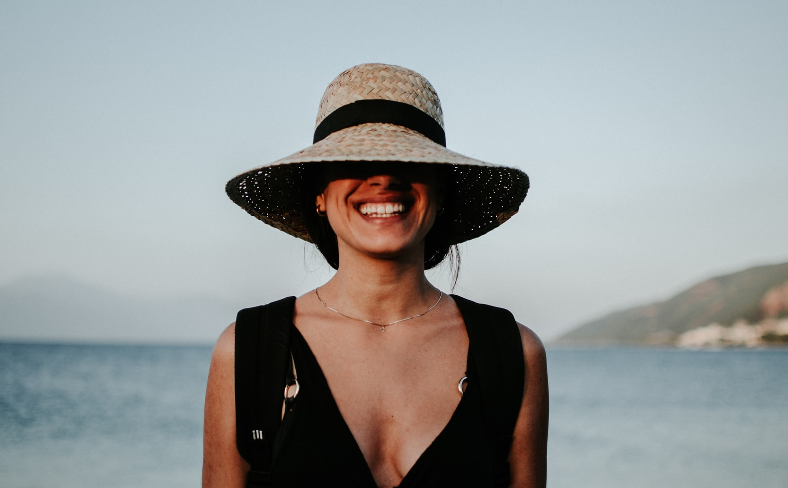 A smiling lady with a hat